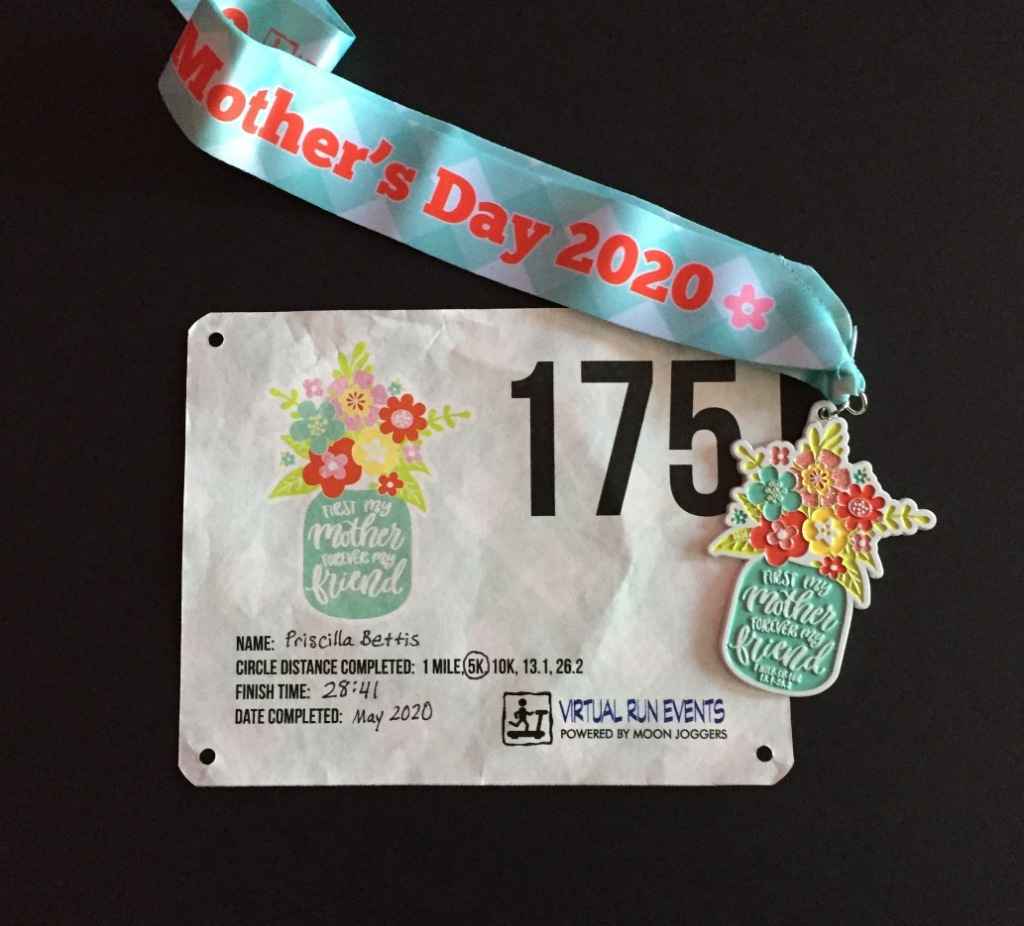 Image of running race bib and medal