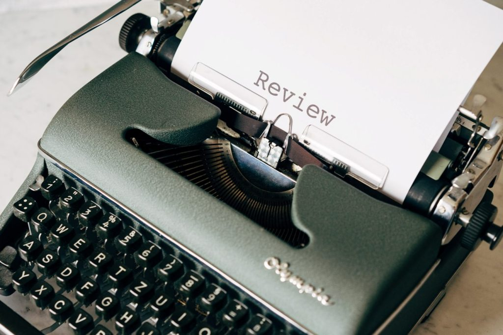 Image of typewriter with a book review being typed