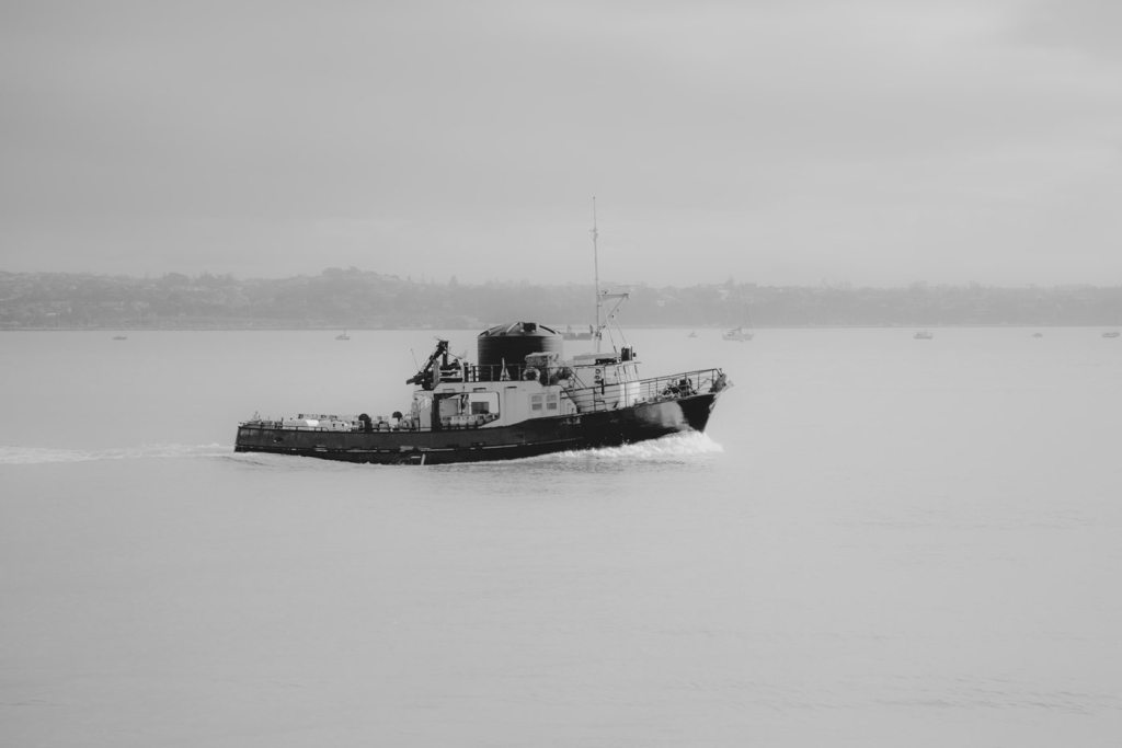 Image of a boat chugging up a river